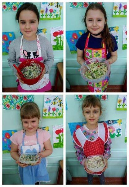 Uczniowie klasy 1A prezentują swoje wiosenne sałatki